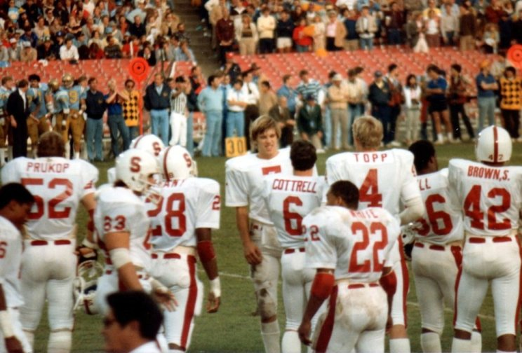 Stan Gill wore number 36 for the Cardinal and walked the sideline with John Elway