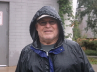 Coach Turner in the rain in the summer of 2014 with a few minutes to spare for a former player