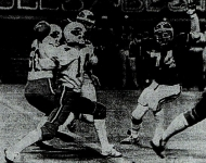Audie McKee passes over Ray Short in the Battle of the Unbeatens in 1983